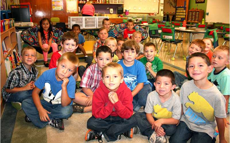 by: PEGGY SAVAGE - The eager faces of first graders in Connie Yates' class at the start of their first day of school at Rural Dell Elementary.