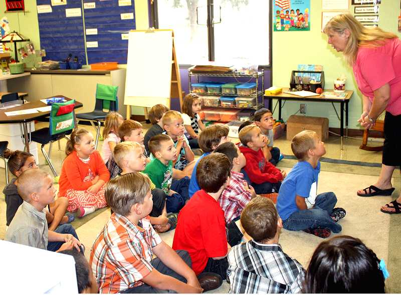 by: PEGGY SAVAGE - Teacher Connie Yates gets to know her little students