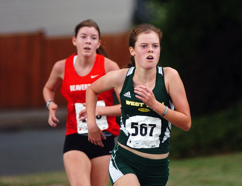 by: DAN BROOD - West Linn freshman Johanna Briscoe looks to break free from the pack in last week's Tualatin Invitational. She finished in third place individually in the event.
