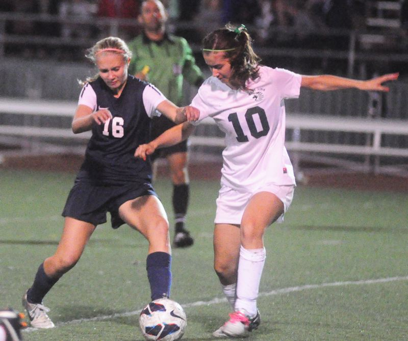 by: MATTHEW SHERMAN - Emily Elott, left, is back as part of a strong midfield for a Lake Oswego team that hopes to challenge for a league title.