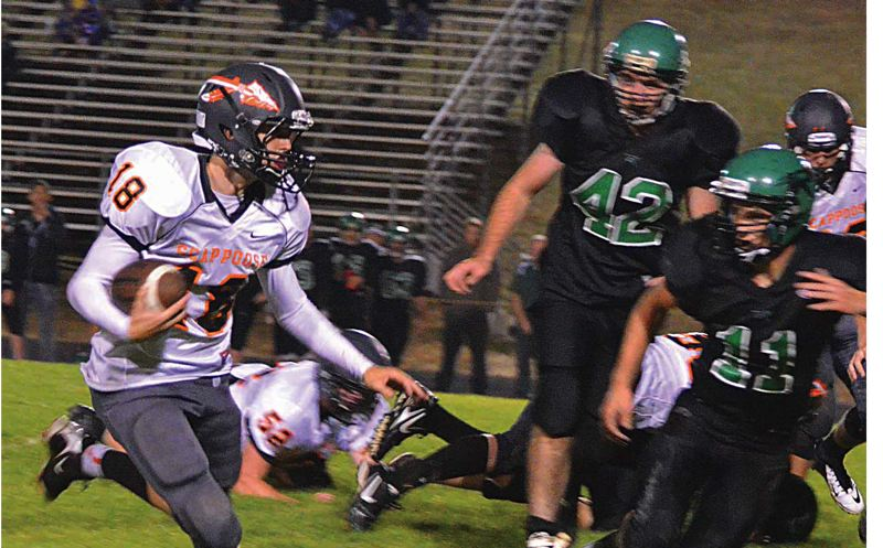 by: FILE PHOTO - Quarterback Taylor Loss runs the ball in last year's match up with Rainier. Scappoose knocked off the Columbians 40-22 last season.