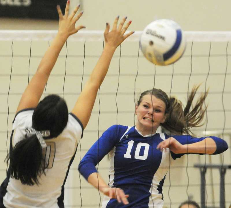 by: LON AUSTIN/CENTRAL OREGONIAN - Karlee Hollis hits the ball past a blocker from Banks for one of her 15 kills in the match. Hollis added 13 kills in a match against Madras later in the evening as Crook County won both matches to remain undefeated on the year.