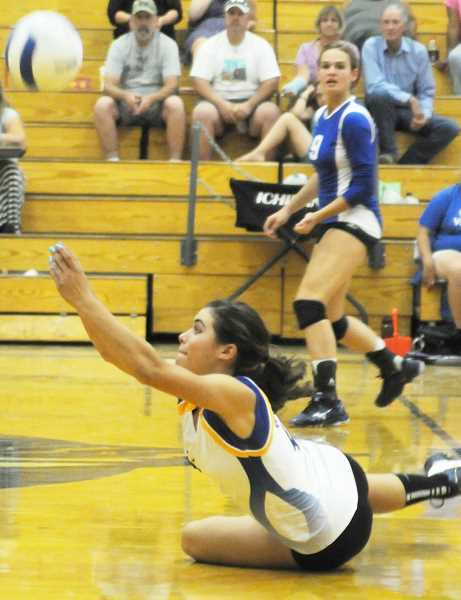 by: LON AUSTIN/CENTRAL OREGONIAN - Laken Berlin follows through after diving on the floor for a dig during the Cowgirls' victory over the Banks Braves on Tuesday. Berlin led the Cowgirls in digs on the night with 21 against Banks, and 15 against Madras.