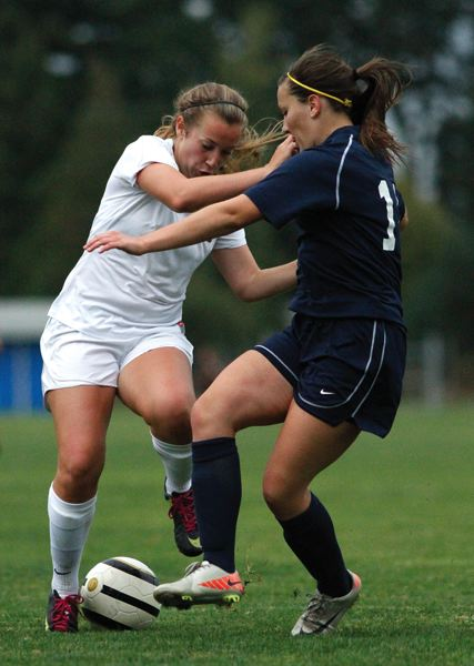 by: HILLSBORO TRIBUNE PHOTO: AMANDA MILES - Glencoe senior Grace Diller (left) battles Liberty junior Haley Hanns for control of the ball during a non-league soccer match last Thursday.