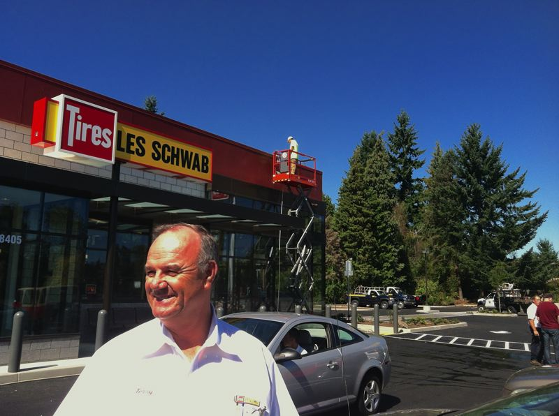 by: SPOTLIGHT PHOTO: MARK MILLER - Terry McMahon, Les Schwab Tire Center manager, out in front of the automotive parts stores new building south of St. Helens.