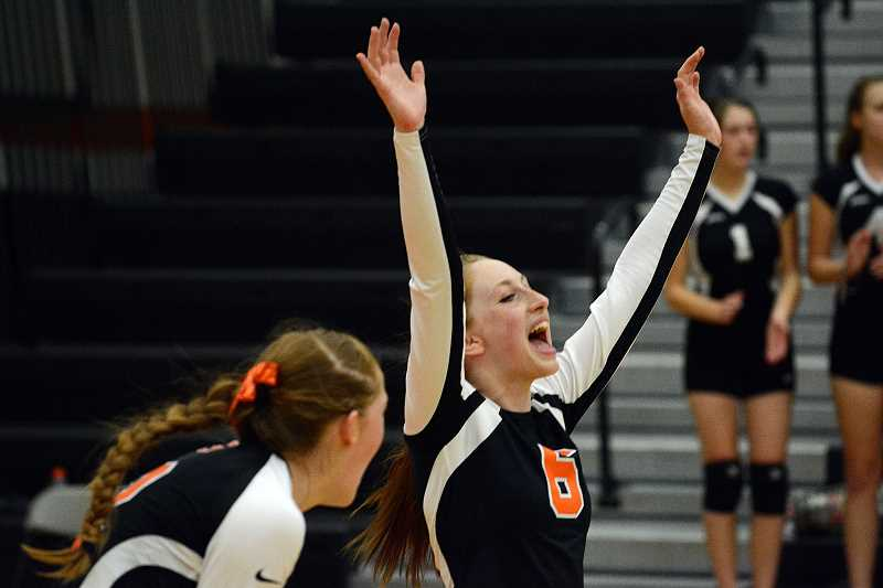 by: JOHN WILLIAM HOWARD - Alyssa Spang (6) celebrates after Scappoose won the first set from Central 25-14.