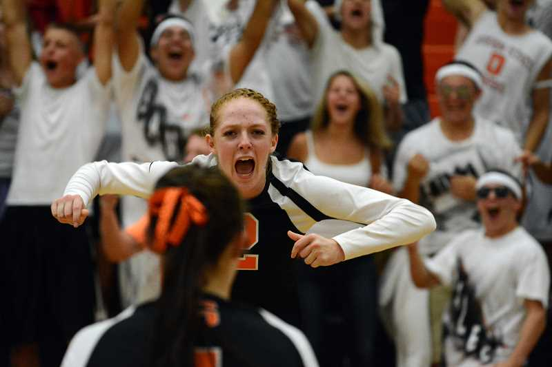 by: JOHN WILLIAM HOWARD - Sophomore Hannah Carey cheers after winning a point to tie the the third set at 24. Scappoose lost the set, but came back and won the fourth set to finish off Central on Thursday, Sept. 12.