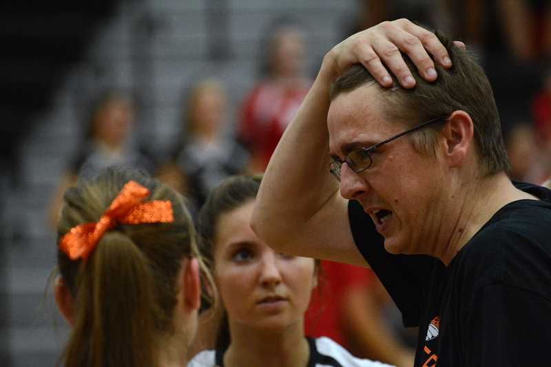 by: JOHN WILLIAM HOWARD - Coach Mark Sprenger talks with his players during a timeout. Sprenger was pleased with the defensive effort by Scappoose, who defeated Central 3-1 on Thursday, Sept. 12.