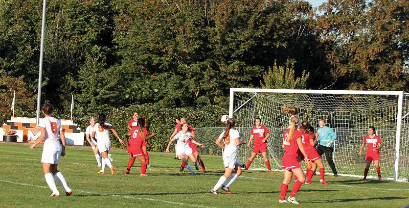 by: CORY MIMMS - Audrey Bever goes for the goal off a corner kick from Bianca Delgado.