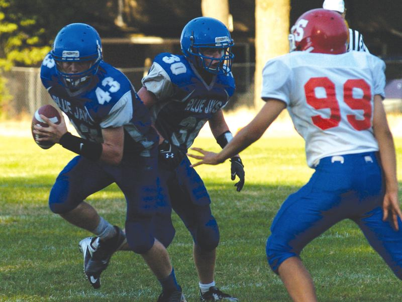 by: THE OUTLOOK: DAVID BALL - Portland Lutheran QB Jonathon Parrish looks to gain yards on the ground during Fridays loss to Spray.