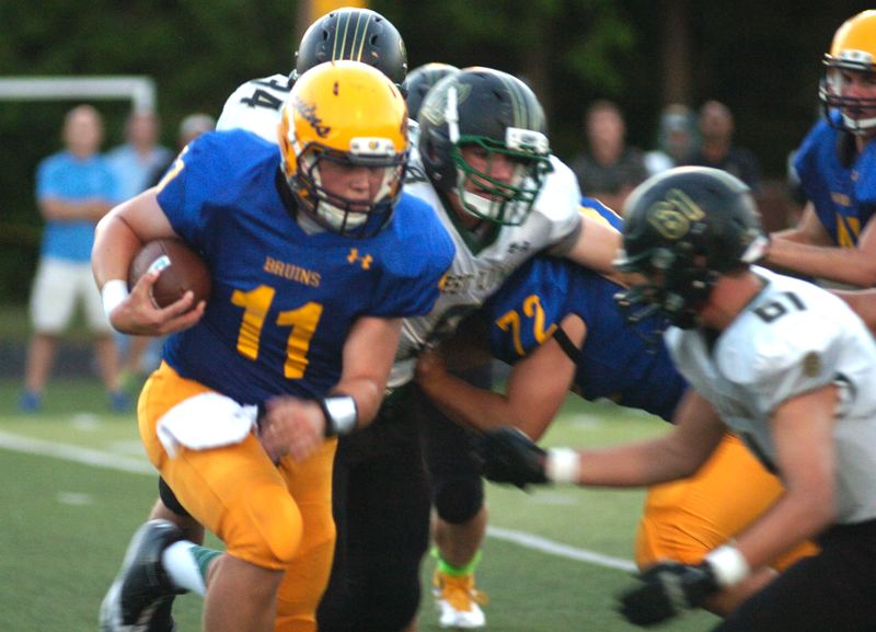 by: THE OUTLOOK: DAVID BALL - Barlow quarterback Alex Plusquellec looks for room to run during the first half Friday.