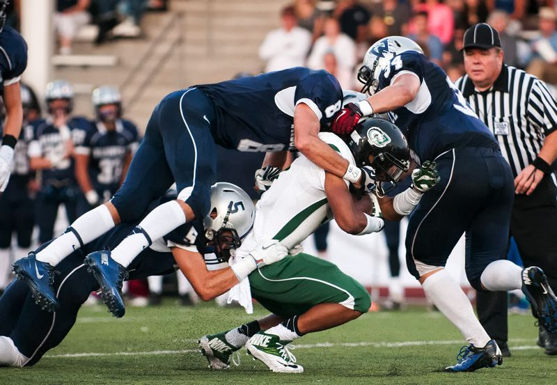 by: SPOKESMAN PHOTO: JOSH KULLA - Parkrose found little running room Friday in a 42-6 loss at Wilsonville.