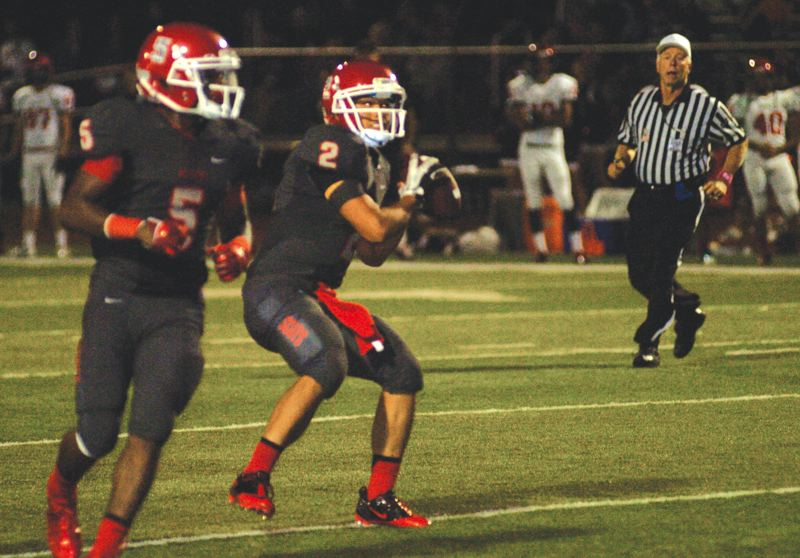by: THE OUTLOOK: DAVID BALL - David Douglas QB Henry Vu looks for an open receiver during Fridays 35-0 loss to Oregon City.