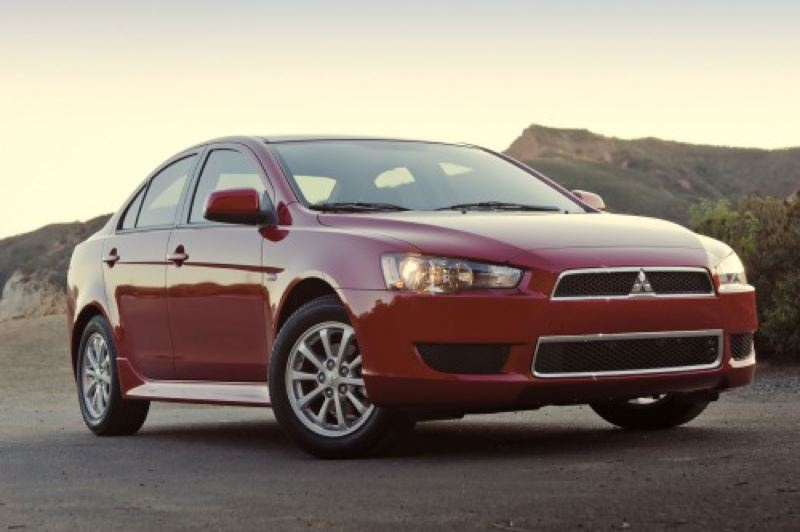 by: MITSUBISHI MOTOR SALES OF AMERICA - Sporty good looks help the 2014 Lancer compete against newer challengers.