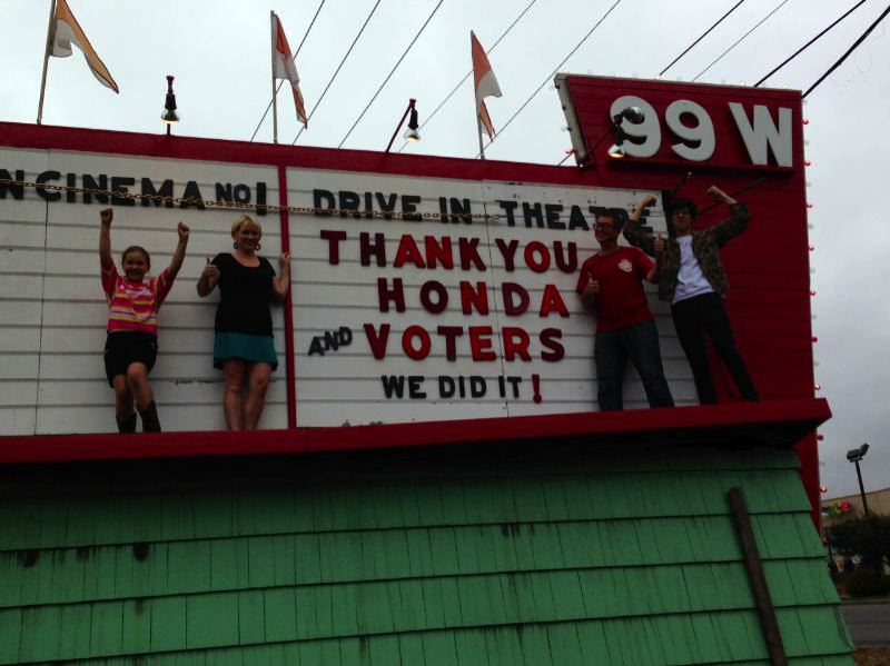 (Image is Clickable Link) by: COURTESY OF HONDA - Members of the Francis family in Newberg celebrated Sunday, Sept. 15, the new digital movie projector the 99W Drive-In will get from Honda Motor Co.'s project drive-in.