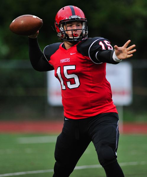 by: PHOTO BY JOHN LARIVIERE - Oregon City quarterback Jon Hall