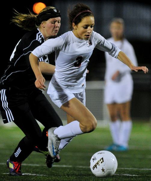 by: JOHN LARIVIERE - Clackamas returns eight starters from last years girls soccer team that advanced to the state final, including Riley Mitchell (3) and Holly Hunt (12), pictured playing Thurston for the 2012 state title.