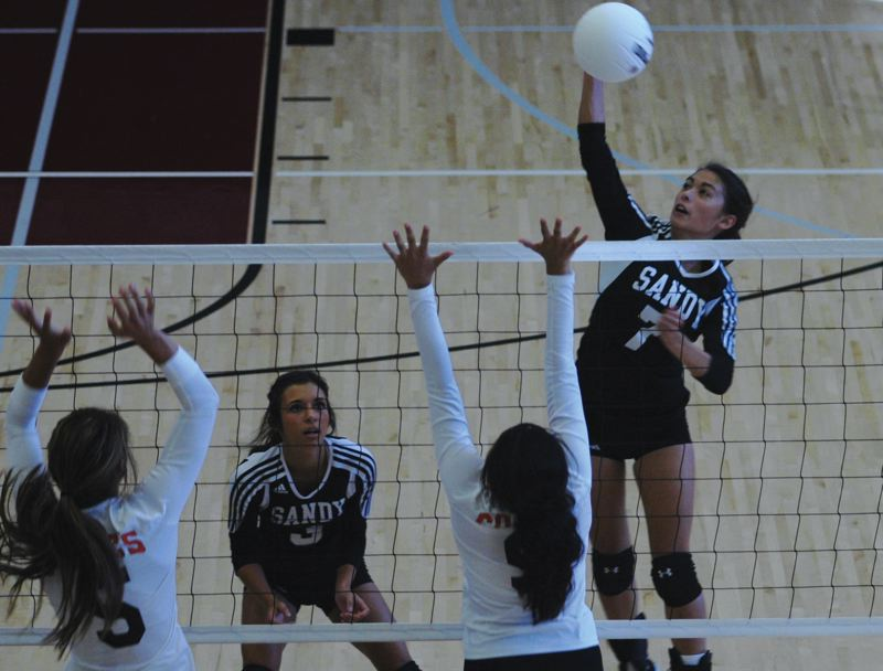 by: SANDY POST: PARKER LEE - Kayla Anderson rises into the air to deliver a kill Saturday against Silverton.