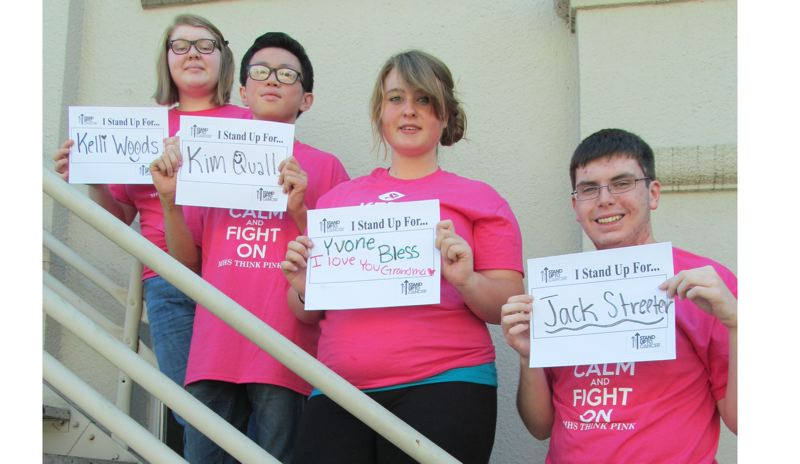 by: PHOTO BY ELLEN SPITALERI - MHS ASB officers demonstrate the 'I Stand For' activity they plan for the football game on Sept. 27. Left to right: Courtney Ryman, Jackie Liang, Arrow Bless and Brandon Kneebone.