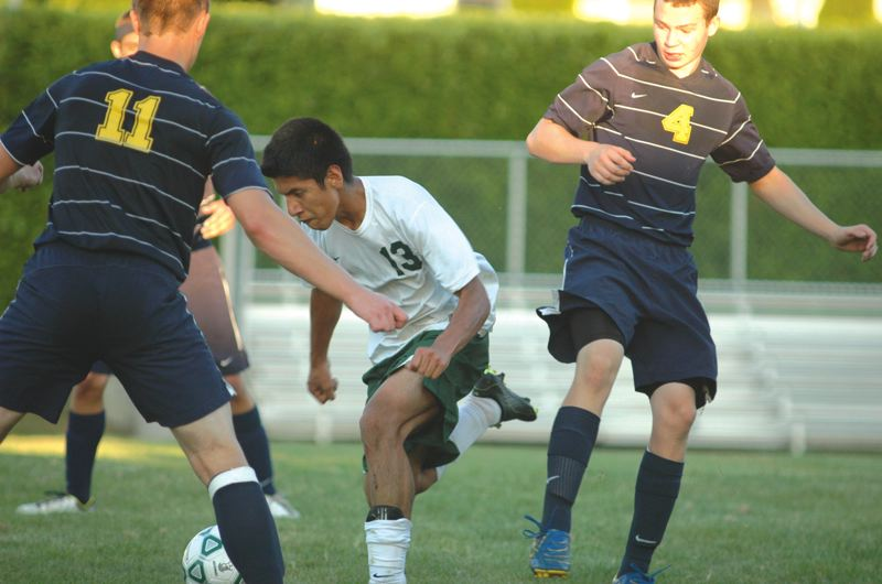 by: ESTACADA NEWS: PARKER LEE - Estacadas Alfredo Belman fights through traffic to get to the mouth of the goal during last weeks 4-2 loss to Banks.
