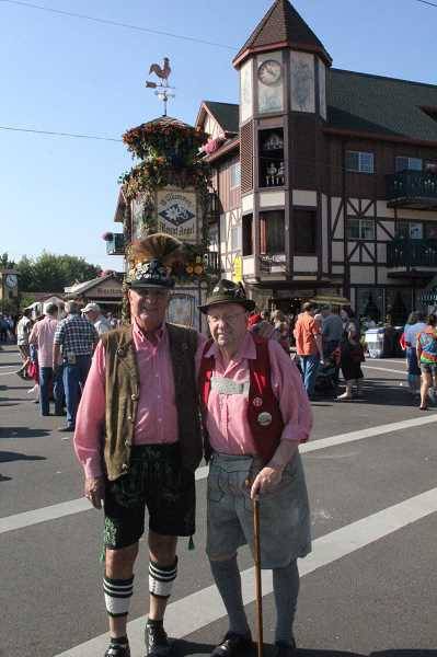 by: JEFF MCDONALD - Longtime festival participants Jerry Lauzon and Larry Petroski wear full lederhosen in the downtown streets.