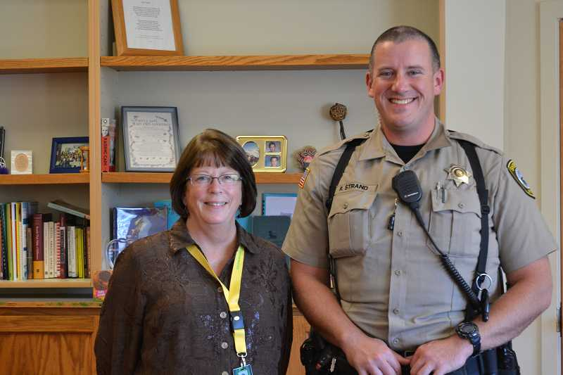 by: CINDY FAMA - Colton Superintendent Linda Johnson with new school resource officer, Robert Strand.