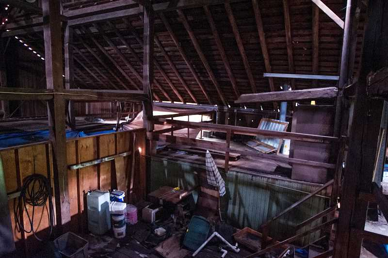 by: JOSH KULLA - A long-unused office sits in one corner of the old barn, strewn with discarded papers and other materials.