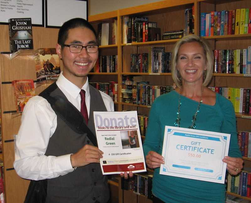 by: SUBMITTED - The Wilsonville Friends of the Library-Wilsonville Area Chamber of Commerce August Partner drawing was held recently, with each of the four winners receiving a $50 gift certificate from Redial Green for products and/or services. Pictured are, Galen Kenney, left, with Redial Green owner Heather Ward. Not shown are winners Kathy Litts, Susan Paysend and Teri Thurston.