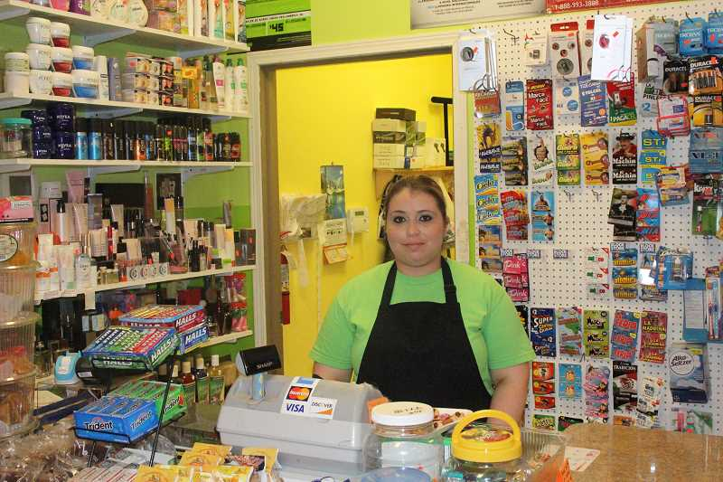 by: JEFF MCDONALD  - Victoria Rodriguez, owner of the Guacamole Market in Woodburn, said she has beefed up security measures since the market was robbed Sept. 6. But she still feels scared.