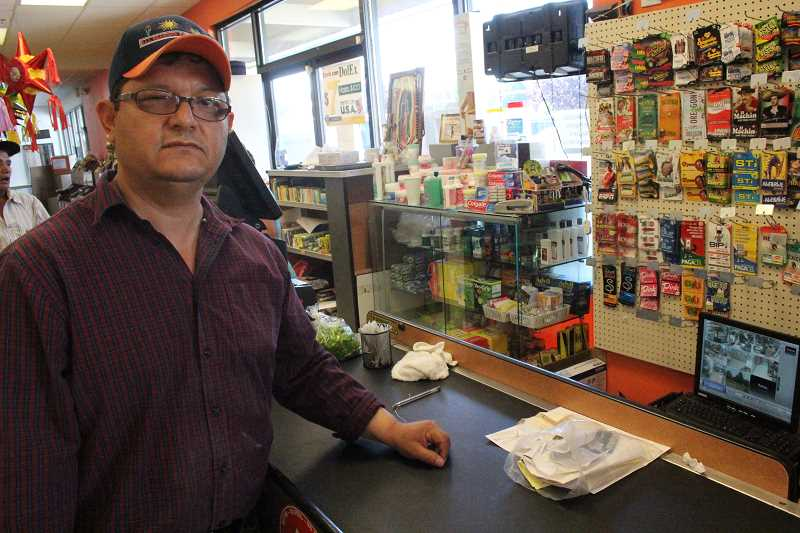 by: JEFF MCDONALD  - Ezequiel Escobedo Lopez, owner of Tienda Mexicana in Woodburn, has avoided robberies using advanced security systems. But mostly he is trying to promote getting to know his customers, he said.