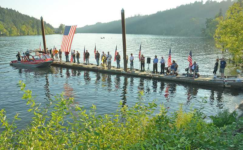 by: VERN UYETAKE - The flag was again raised at the Willamette Park boat ramp for last week's 9/11 ceremony.