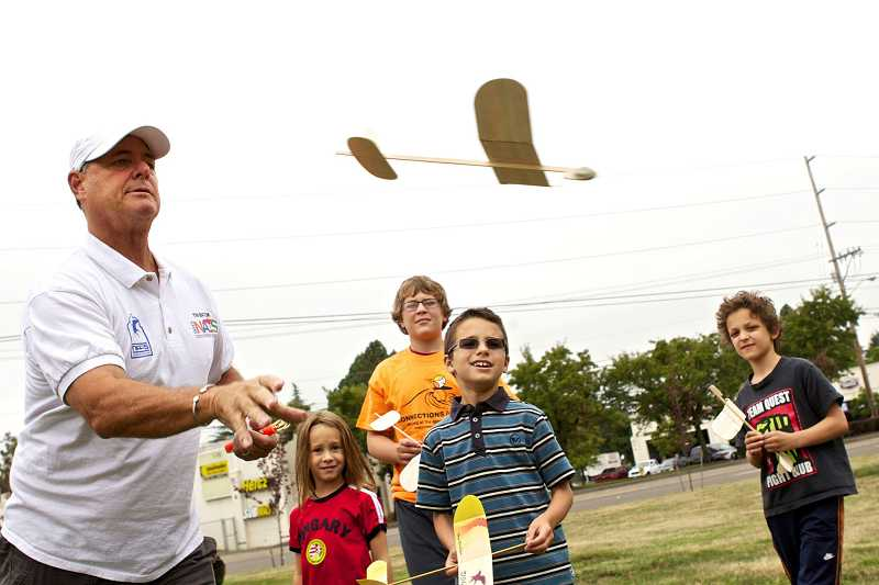 by: TIMES PHOTO:JAIME VALDEZ - Tim Batiuk from the California Connections Academy, shows Cara Stasiewicz, a first-grader at Connections Academy, how to launch a model plane.