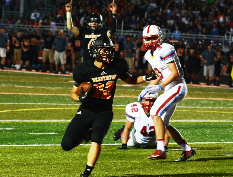 by: TIMES PHOTO: MATT SINGLEDECKER - Beaverton running back John Ahn heads into the end zone for the Beavers third straight score against South Salem.
