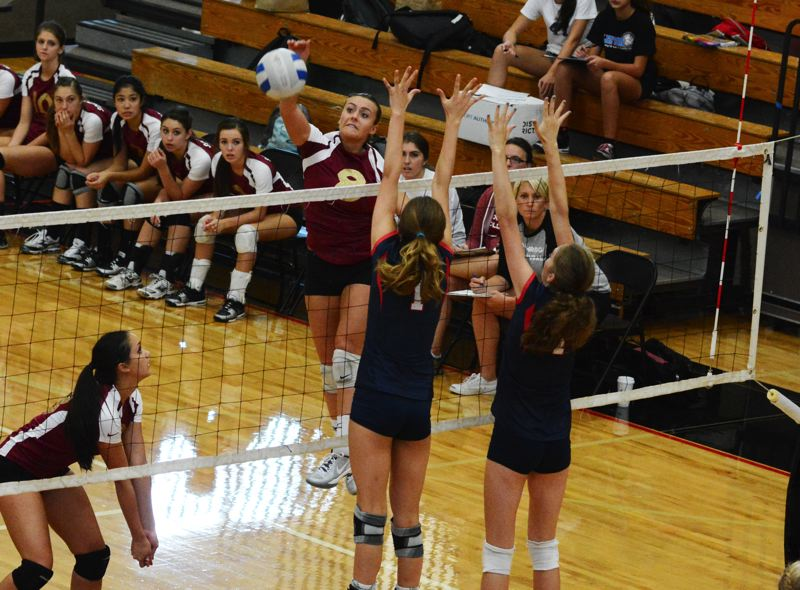 by: TIMES PHOTO: MATT SINGLEDECKER - Southridge outside hitter Nicole Rigoni thumps a spike at the Lake Oswego defense during the Skyhawks four-set loss on Thursday.