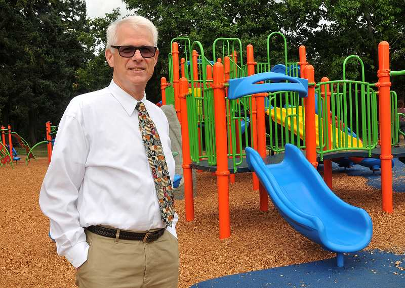 by: REVIEW PHOTO: VERN UYETAKE - Westridge Principal Scott Lane poses by his school's new play equipment.