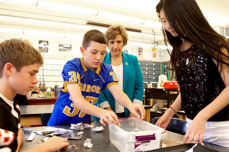 by: TIMES PHOTO: JAIME VALDEZ - During Friday's visit at Highland Park Middle School, Congresswoman Suzanne Bonamici observes students in Karen Nelson's seventh-grade science class as they engage in a project.