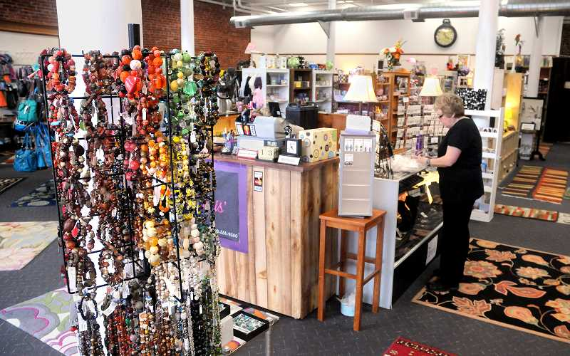 by: GARY ALLEN - A moving experience - Janis Schroeder, owner of Janis Jewelry and Gifts, has more open space to ­display her merchandise at the new 616 E. First St. location, Velour will take over the old Janis Jewelry location at 718 E. First St.