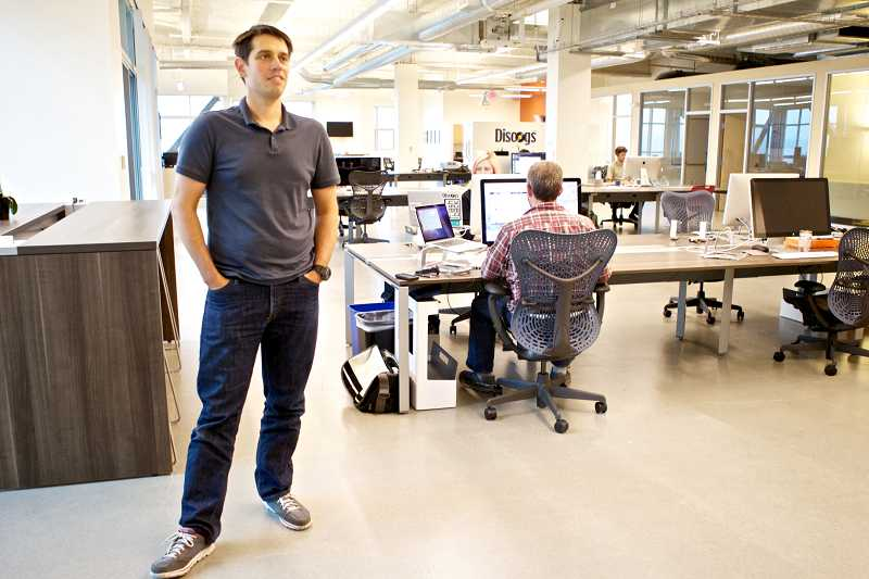 by: TIMES PHOTO: JAIME VALDEZ - Discogs CEO Kevin Lewandowski talks about his company's move into a fifth-floor office space at The Round at Beaverton Central.
