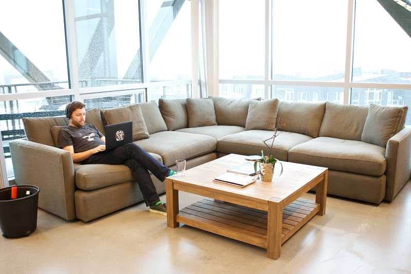 by: TIMES PHOTO: JAIME VALDEZ - Wes Rogers, who is a technical lead at Discogs, goes through resumes to hire a new employee in the lounge area of the Beaverton company.