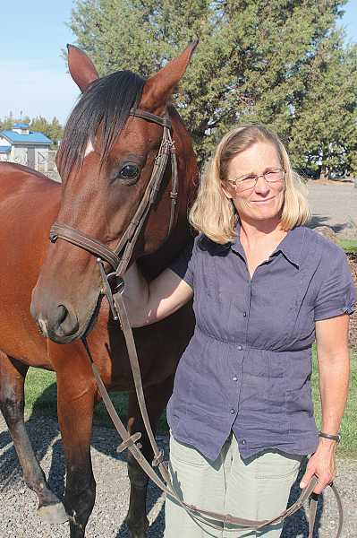 by: HOLLY M. GILL - Karen McCarthy, of Madras, has rehabilitated the horse known as 'HoneyBadger,' which is now ready for a new owner.