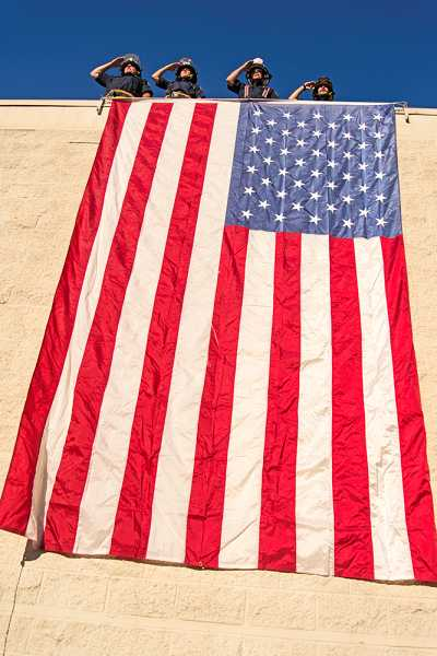 by: RAY HUGHEY - Canby firefighters recreated the draping of the flag at the damaged Pentagon.