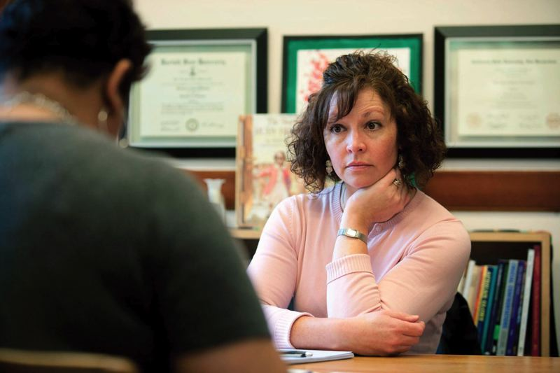 by: TRIBUNE FILE PHOTO: CHRISTOPHER ONSTOTT - Mary Krogh, former Portland Public Schools ombudsman, talked in 2011 with a district administrator about how to improve communication with parents.