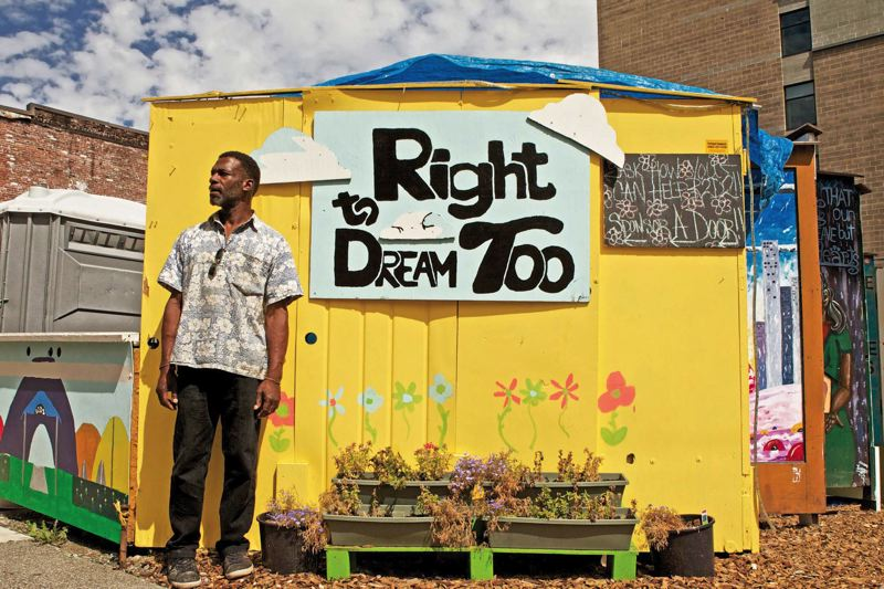 by: TRIBUNE PHOTO: JAIME VALDEZ - A resident who gave his name as Clarence stands outside Right 2 Dream Too, which city commissioner Amanda Fritz says would have been judged in compliance with city code - if property owners had gone through the city's permitting process.