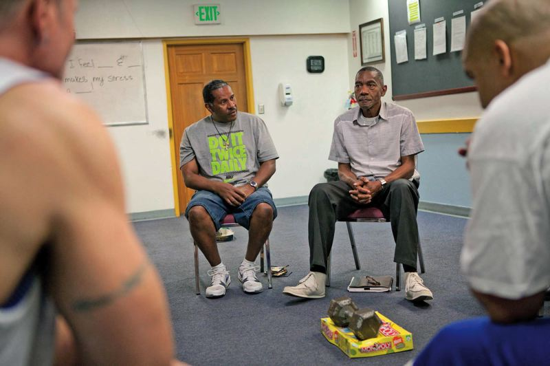 by: TRIBUNE PHOTO: ADAM WICKHAM - Larry Jones (left) and Karl Colbert have been living at the VOA residential facility in NE Portland for over four months. Group sessions there are aimed at  getting beyond addiction to the psychological roots of their criminal behaviors.
