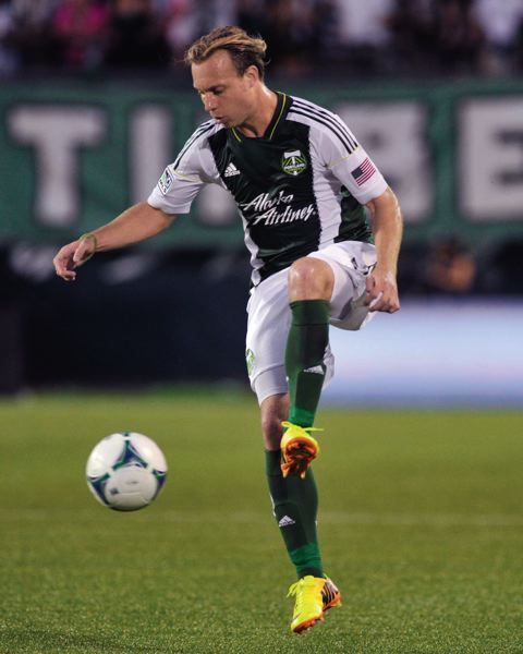 by: COURTESY OF JOHN LARIVIERE - Portland Timbers defender Michael Harrington gives the back line some welcome consistency and experience.