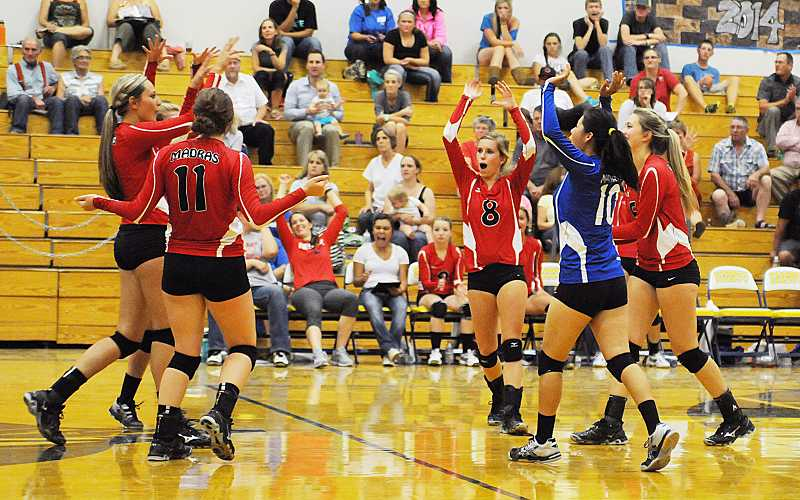 by: PHOTO BY LON AUSTIN/CENTRAL OREGONIAN - The Madras High School volleyball team celebrates a point during a match with Crook County in Prineville.