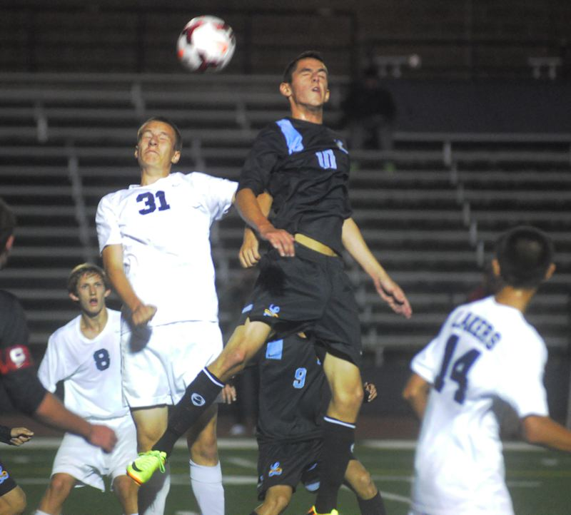 by: MATTHEW SHERMAN - Lake Oswego's Max Moede, left, and Lakeridge's Bruno Homedes elevate for a header during Tuesday's 0-0 draw at Lake Oswego High School.