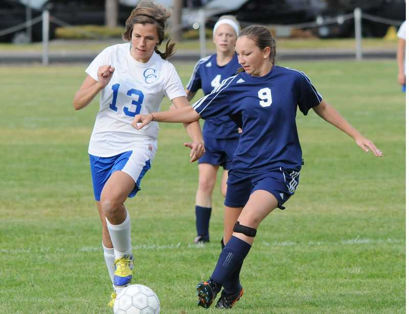 by: LON AUSTIN/CENTRAL OREGONIAN - Cierra Tyger blows past a La Pine Hawk defender on the way to the goal. Tyger scored on the play, helping the Cowgirls to a 2-1 victory over the Hawks.
