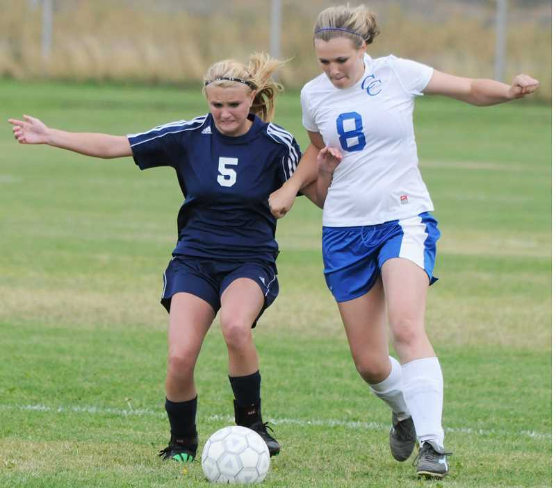 by: LON AUSTIN/CENTRAL OREGONIAN - Kelsie Smith fights for the ball with a La Pine forward. Smith helped anchor a Cowgirl defense which gave up just one goal in the game.