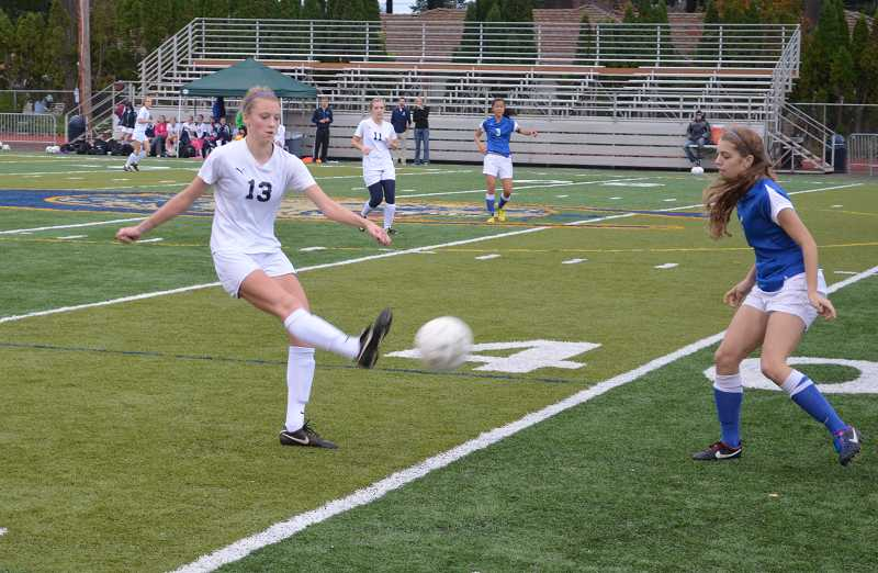 by: JEFF GOODMAN / FILE - Olivia Baggerly is one of several returning seniors for the Canby girls soccer team this year. Last season, the Cougars advanced past the second round of the state playoffs for the first time in program history.